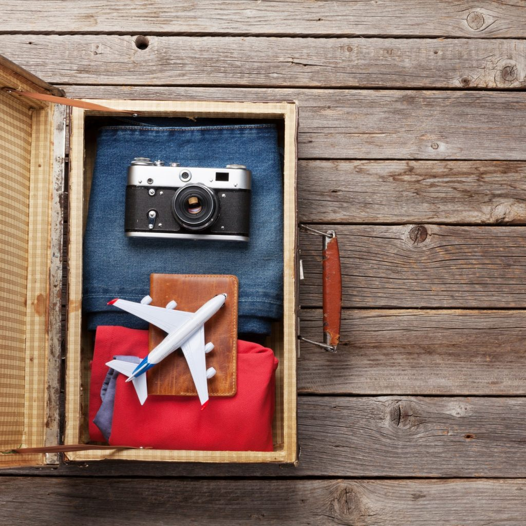 Suitcase with clothes and travel accessories